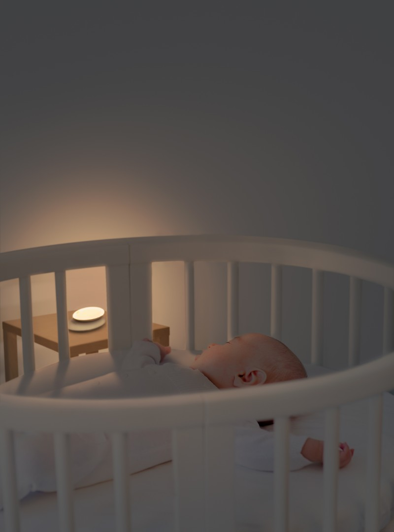 Veilleuse portative Meelight Meemoobaby bébé dans son berceau